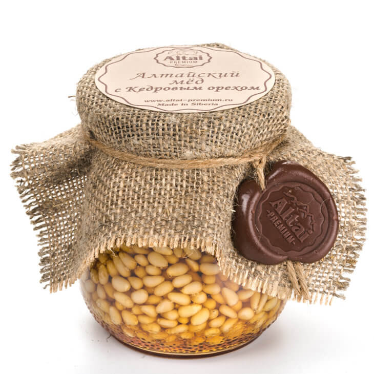мед с орешками в банке